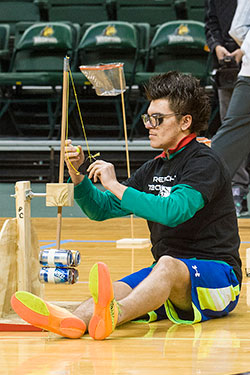 photo of a student competing in the trebuchet competition
