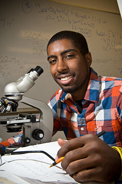 photo of a student using a microscope