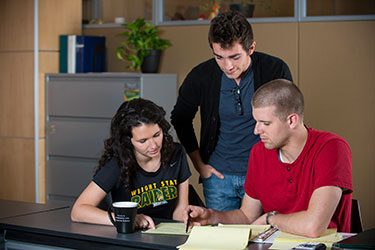photo of three students studying together