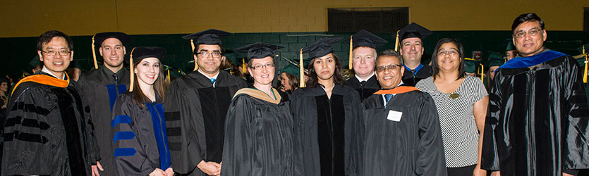 photo of graduates and faculty at commencement