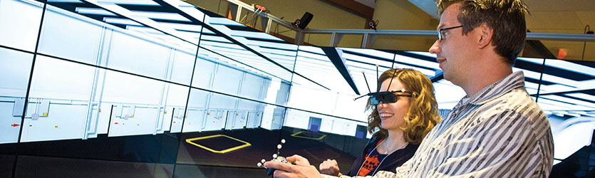 photo of a student and professor in the visualization lab